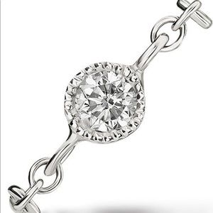 Maria tash white diamond double piercing
